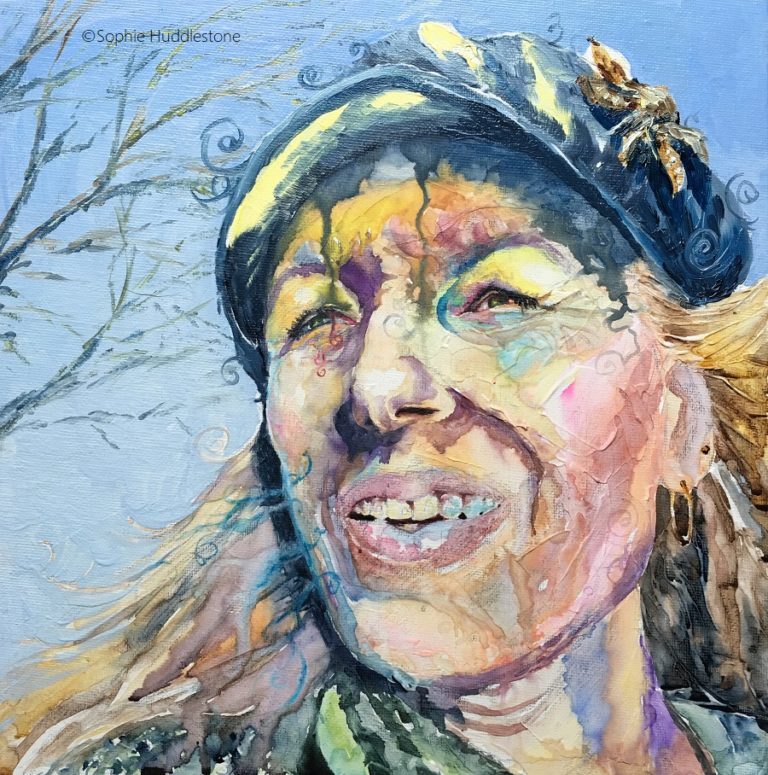 Self Portrait called 'Forgetful' by Sophie Huddlestone 2019. Walking to fetch my daughter from school I had forgotten my blue tinted Irlen Syndrome glasses and was squinting with the brightness of the sun. Painted onto a canvas board and 3D watercolour texture paste was added. Portrait painted in watercolours, the hat and background are in oil paints. I really went wild with this one to see how exaggerated  I could go, mixing complementary colours yellow and blue bringing the main focus on the squinting eyes and the uncomfortable feeling to this portrait.